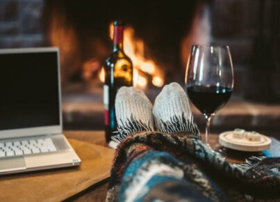 macbook-pro-beside-wine-glass-on-brown-wooden-table-4099298-1024x576